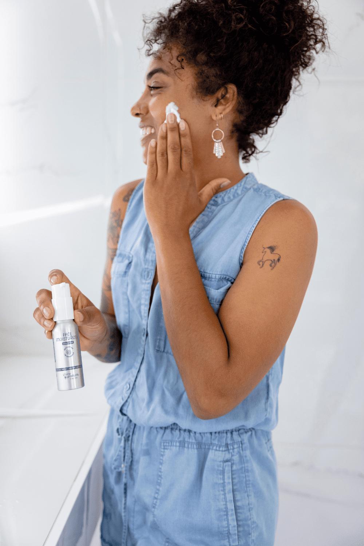 model applying unscented face moisturizer